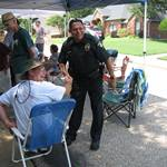 Officer Friendly greets a citizen of Cedar Hill at a town gathering..jpg