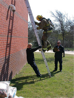 Firefighter Climbing Ladder